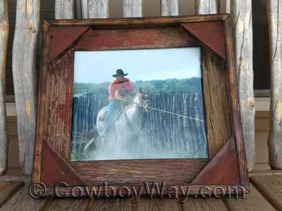 A barn wood picture frame with faded red wood