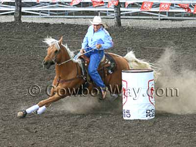 A barrel racer turns a barrel