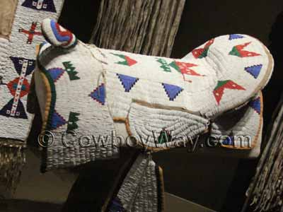 Beaded saddle cover for a horse