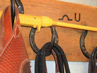Bridle hook made out of horse shoes