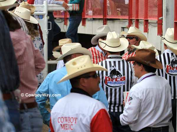 Officials behind the chutes at the  Cheyenne Frontier Days Rodeo