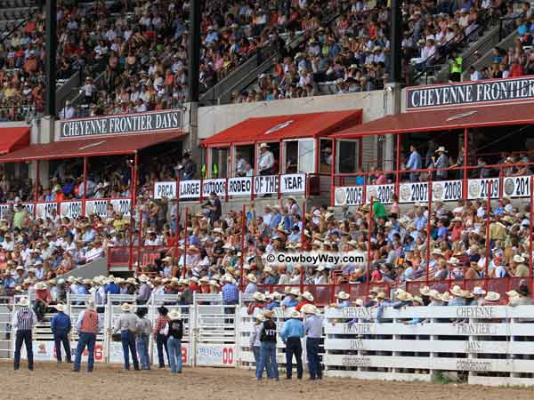 The crowd at the Cheyenne Frontier Days Rodeo watches the bull riding