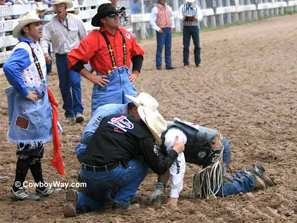 A bull rider gets help