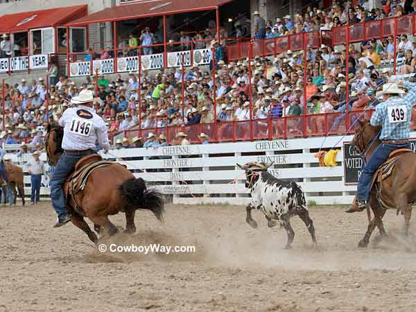 Team roping header Clay Trayan with  heeler Travis Graves