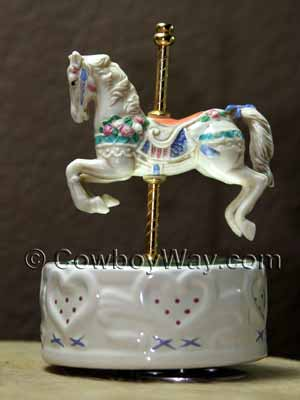 A carousel horse that turns on the base with the music