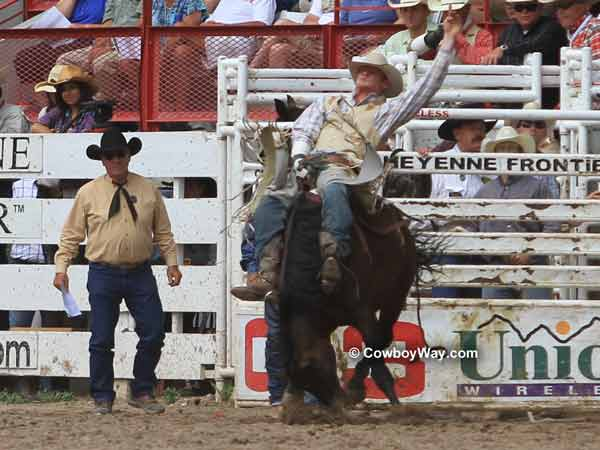 A bronc leaves the bucking chute