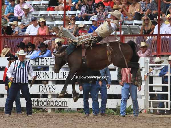 A bareback bronc springs into the air