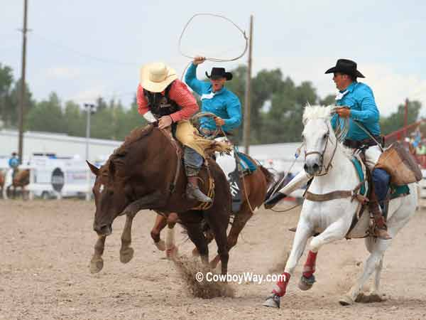 Pickup men move in after a bronc ride
