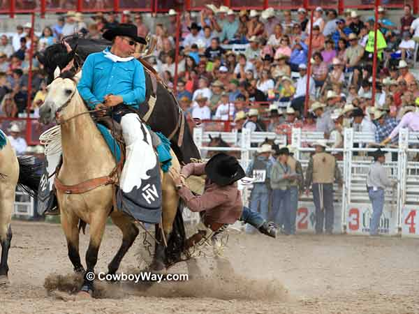 Saddle bronc rider misses the  pick up horse