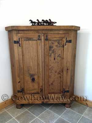 A bathroom with a rustic corner cabinet