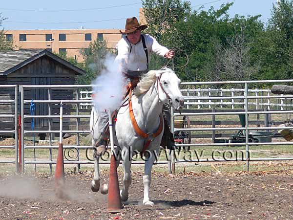 A cowboy mounted shooter shoots the balloon target