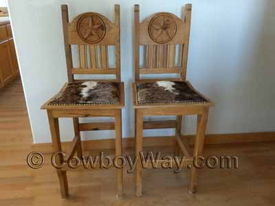 Two hair-on-hide cowhide bar stools