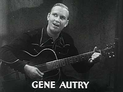 Gene Autry playing a guitar