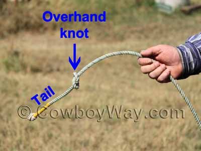 To put a horn knot on your rope, tie a knot toward the end of the rope