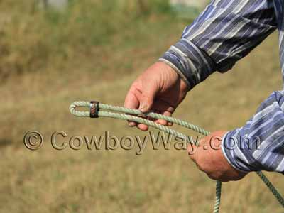Slide the horn knot farther down the rope