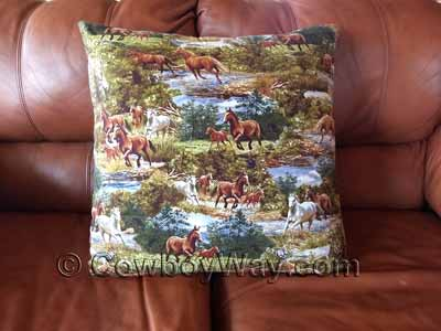 A large pillow with horses