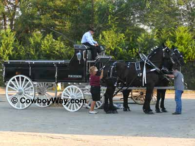 A black wagon and a team of Percherons