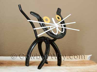 A cat made of horseshoes