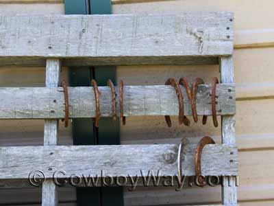 Horseshoes on a wooden pallet