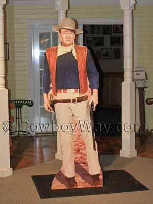 A John Wayne (with rifle) cardboard cutout