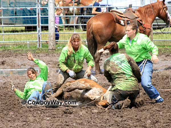 A women's ranch rodeo team completes the tie-down event