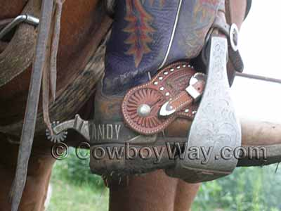 Spur straps and spurs on cowboy boots