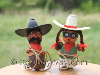 Bride and groom cowboy wedding cake toppers