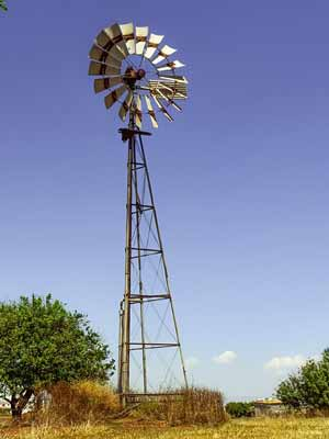 A tall windmill used for pumping water