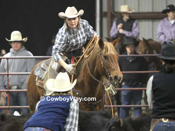 Women's ranch rodeo: A cowgirl ropes heels