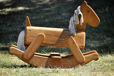 A modern, small wood rocking horse