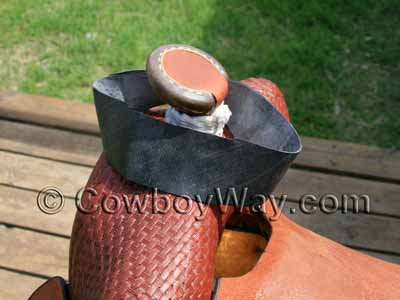 To wrap a saddle horn with rubber begin with one piece of rubber