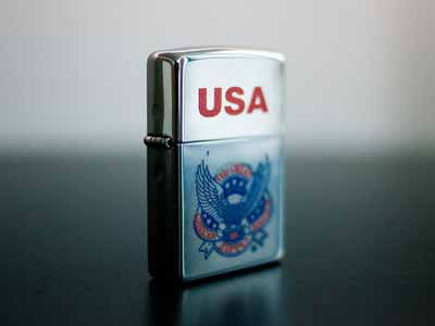A red, white, and blue Zippo lighter