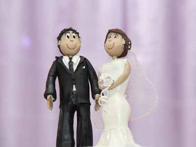 A traditional wedding cake topper